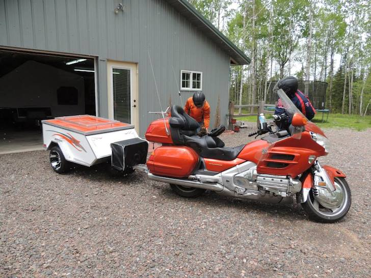 Orange and white motorcycle camper