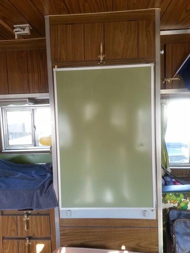 Refrigerator and surrounding wood paneling