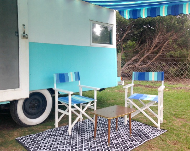 Seating area outside vintage caravan