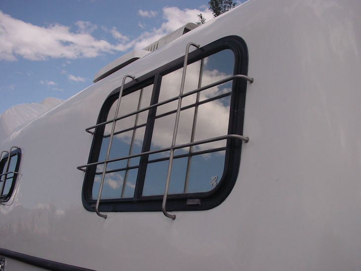 Stainless steel guards on all windows