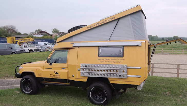 The rear of the Land Cruiser pops up to reveal a lofted bed