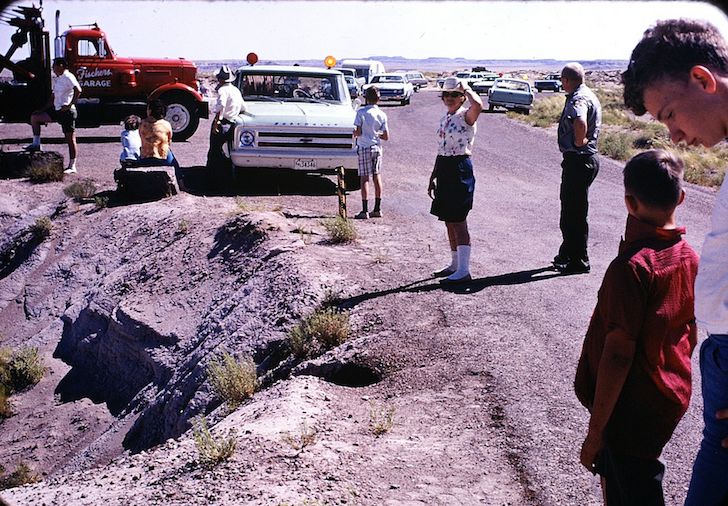 A crowd gathers around the tow truck