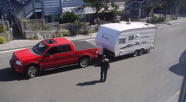 Biker helping back trailer