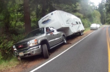 Fifth wheel nearly stuck in ditch