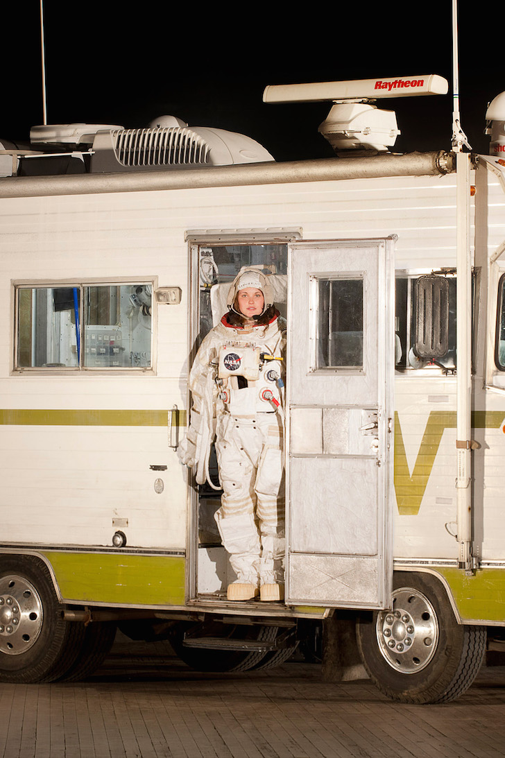 Model standing in door of Winnebago