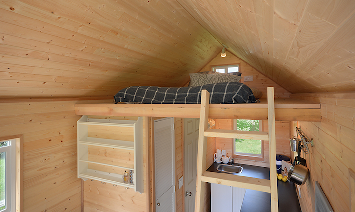 Sleeping loft in tiny home on wheels