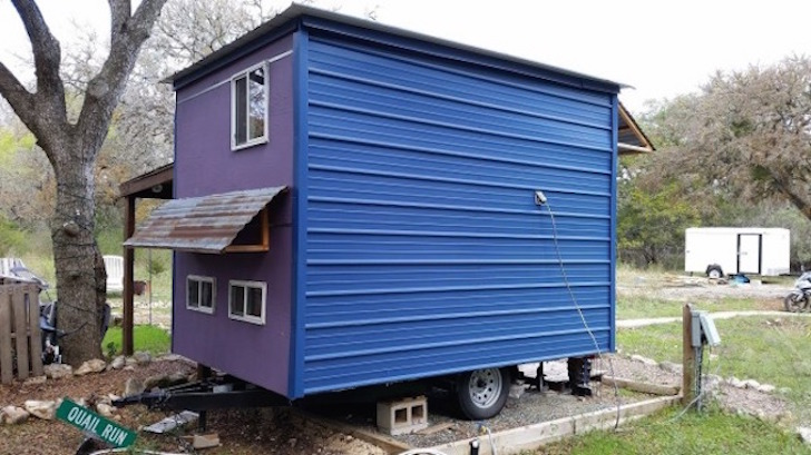 Brightly colored 84 square foot tiny house built on a trailer for Rv square footage