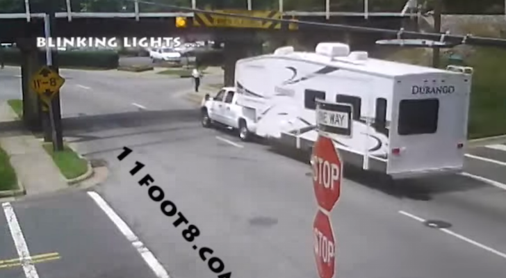 Fifth Wheel Owner Finds Out The Hard Way His Trailer Is Too Tall For This Railroad Bridge