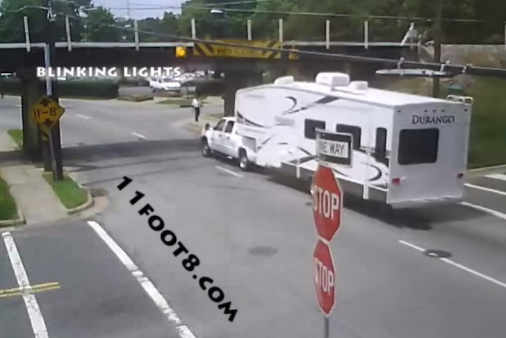 Camper crashes into railroad bridge