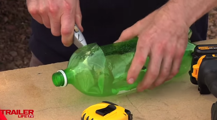 Cut the top off the two liter bottle