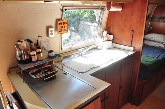 Funny kitchen sign in a vintage trailer for sale