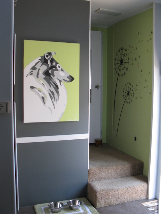 Painting of a dog in an RV
