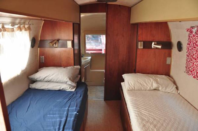 Twin beds in a vintage Airstream trailer up for sale