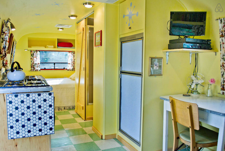 Yellow interior of Airbnb Airstream