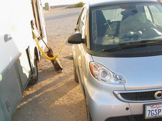 Solar RV charges electric car