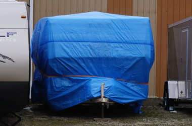 Blue tarp on RV