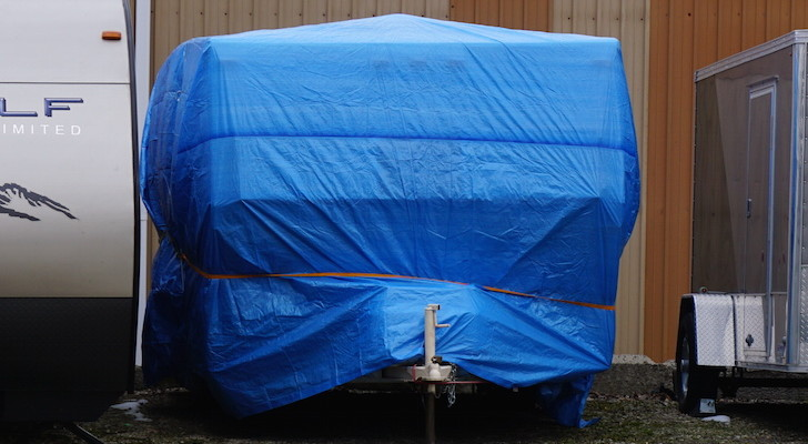 Blue tarp on RV