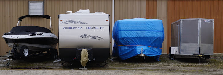 Storing RV with blue tarp