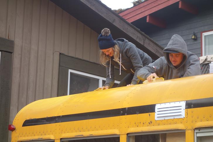 Hand sanding a bus