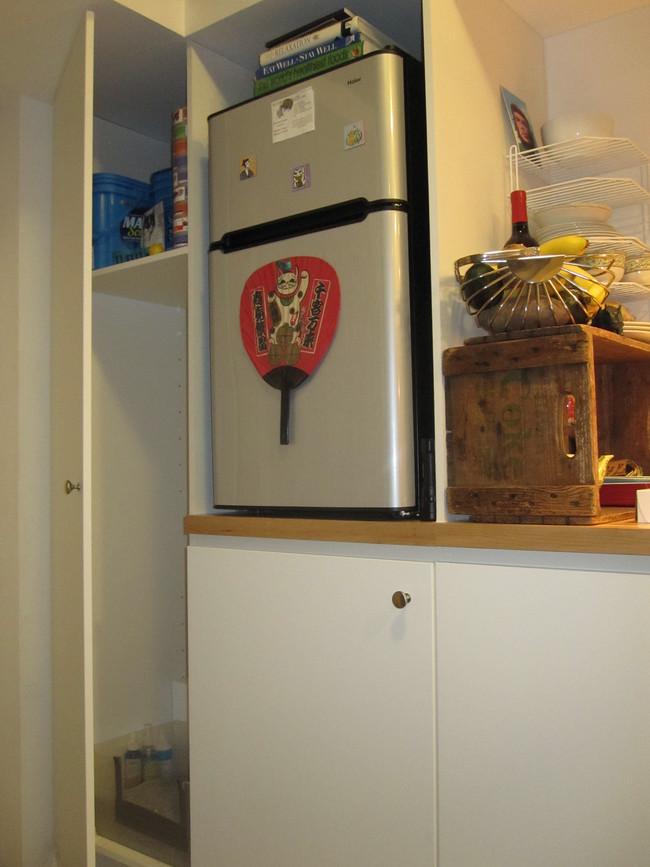 Mini refrigerator in tiny house
