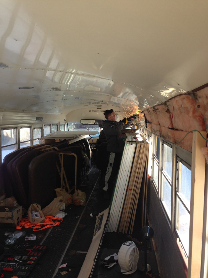 Removing paneling in a school bus