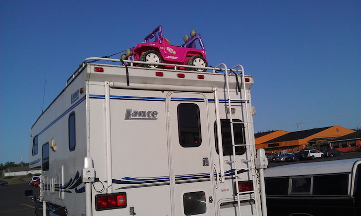 Toy jeep on truck camper
