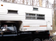 Truck camper bug out shelter