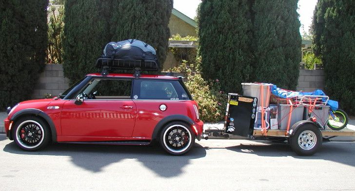 Mini Cooper towing cargo