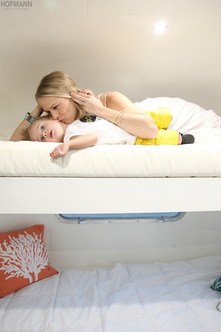 Mother and child use the twin bunk in the master suite