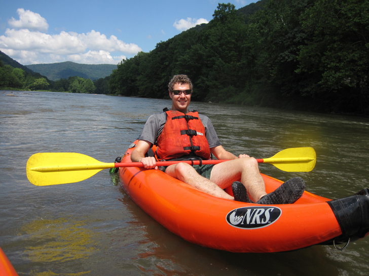 Man in inflatable kayak