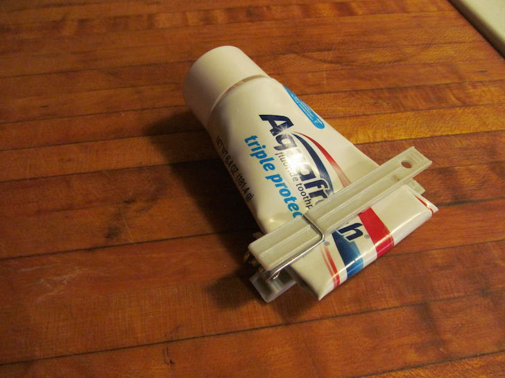 Clothespin toothpaste holder