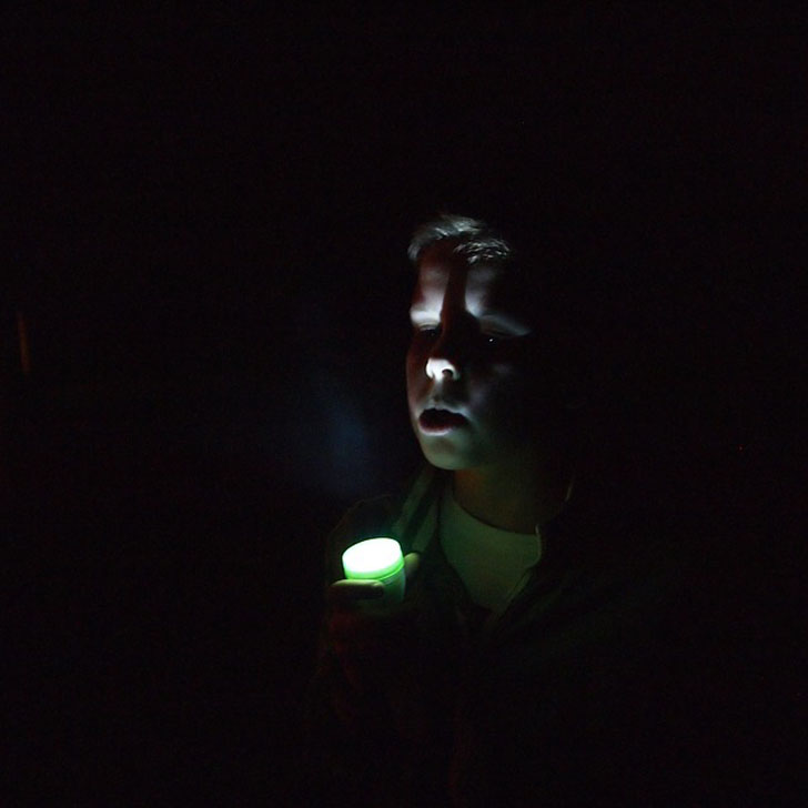 flashlight on face