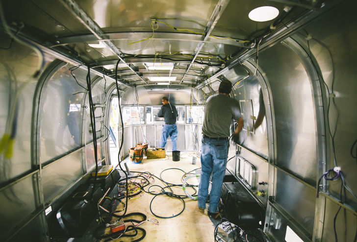 workers building airstream