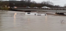 Camper Floating Down A River After Torrential Rains In Missouri