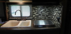 Final Look After Installing Lightweight Tiles In A Camper's Kitchen And Bathroom