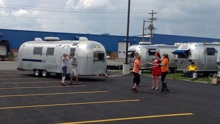 Women pulling Airstream by hand