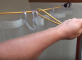 Use Bungee Cords To Make More Room In A Tight RV Shower