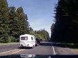 Merging Driver Pulling Fiberglass Camper Nearly Runs RVer Off Road