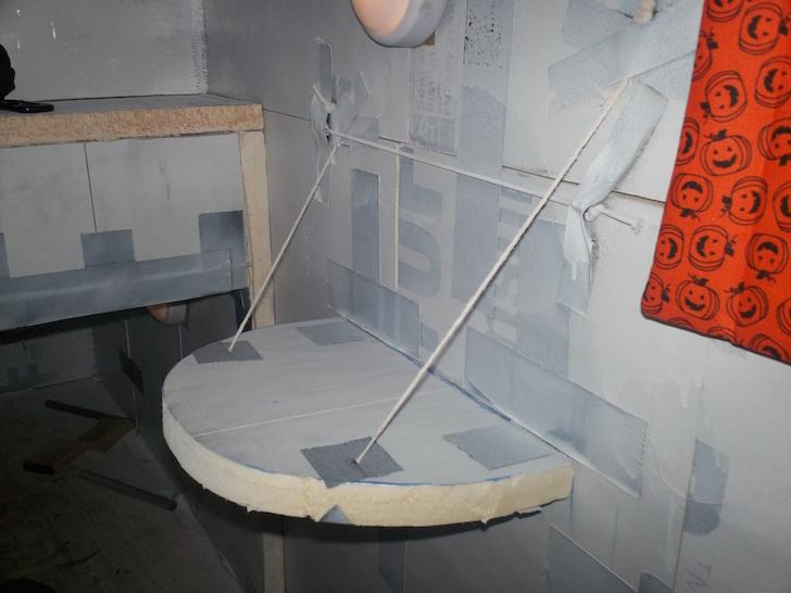 Fold down shelf