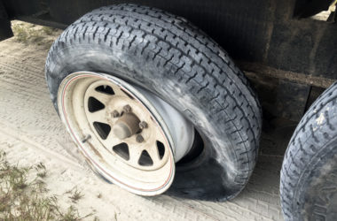 How To Change A Trailer Flat Tire