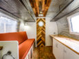 Exposed Wood And Corrugated Metal Highlight This Trailer Makeover