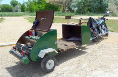 Tiny Motorcycle Camper Transforms From Storage Trailer To Teardrop-Like Sleep Space