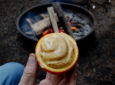 Make These Orange Cinnamon Rolls Over The Campfire [RECIPE]