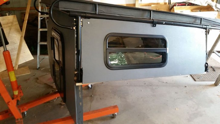 Coated panel on camper