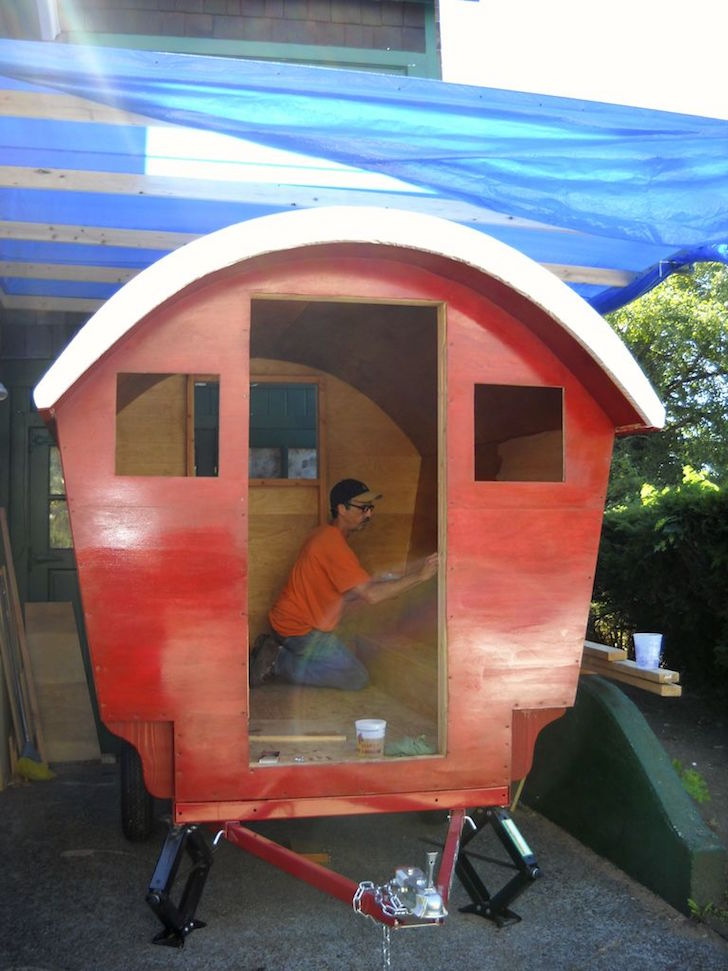 Staining gypsy wagon red
