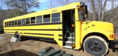 School Bus Turned Into Loft On Wheels For Two (Plus A Dog)