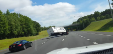 Watch This Out-Of-Control Trailer Flip And Crash On The Highway