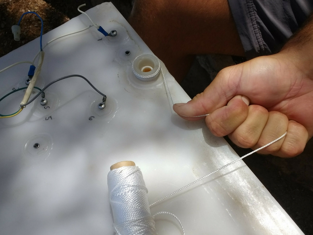 thread-wrapped-around-cracked-tank-outlet