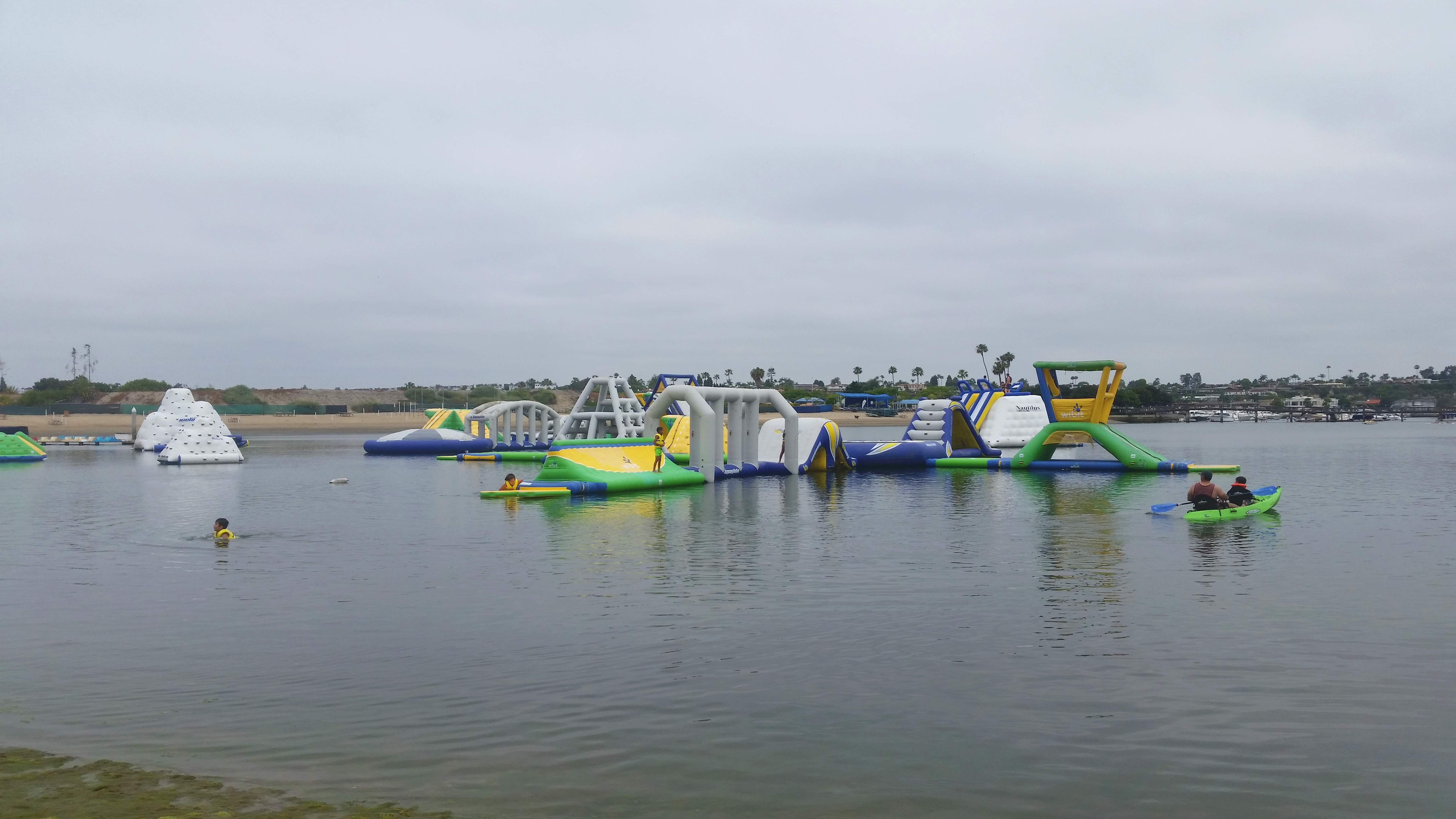 Their waterpark includes a bouncy obstacle course as well as kayak and stand-up paddleboard rentals