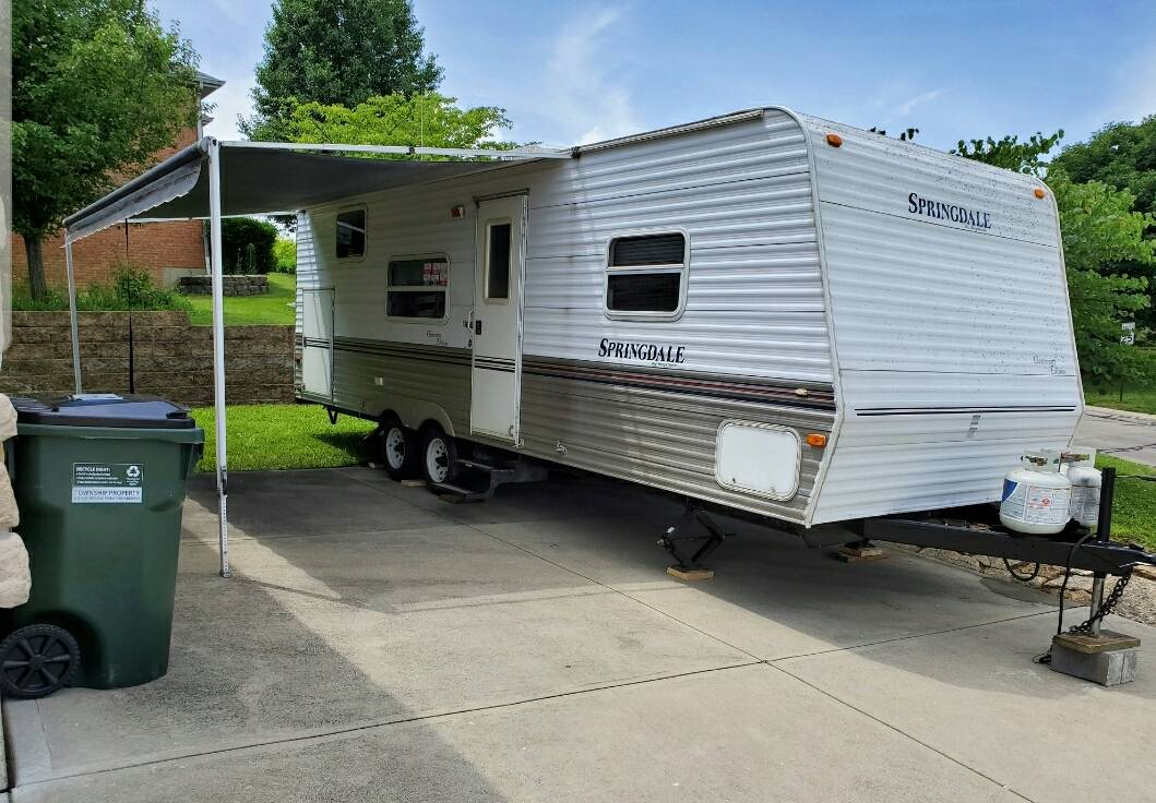 Remodeled Travel Trailers That Look Like Log Cabins